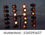 orange shining floodlight... | Shutterstock . vector #1165291627