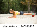 sport woman training outside in ... | Shutterstock . vector #1165313437