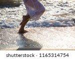 beautiful young woman legs... | Shutterstock . vector #1165314754
