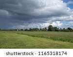 rainy cloudy sky above a bright ... | Shutterstock . vector #1165318174