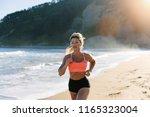 blonde fitness woman running at ...   Shutterstock . vector #1165323004