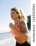 blonde fitness woman running at ...   Shutterstock . vector #1165323061