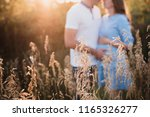 close up of human hands holding ... | Shutterstock . vector #1165326277