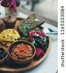 scrambled tofu served with... | Shutterstock . vector #1165333084