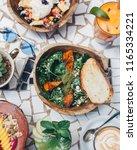 healthy pumpkin salad served... | Shutterstock . vector #1165334221