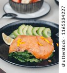 salmon served on toast with... | Shutterstock . vector #1165334227