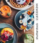 healthy blue smoothie drink... | Shutterstock . vector #1165334344