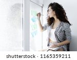 young freelancer girl woman... | Shutterstock . vector #1165359211