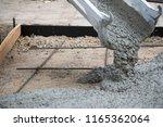 concrete truck chute pouring... | Shutterstock . vector #1165362064