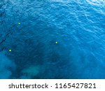 three buoy and sea marker in... | Shutterstock . vector #1165427821