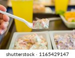 fast food. salad with a plastic ... | Shutterstock . vector #1165429147
