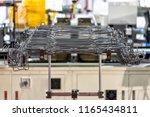 steel wire metal feeding into...   Shutterstock . vector #1165434811