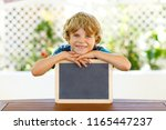 happy little kid boy with chalk ... | Shutterstock . vector #1165447237