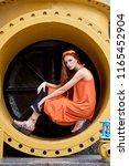 fashionable girl posing in... | Shutterstock . vector #1165452904