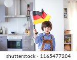 little boy wearing lederhosen... | Shutterstock . vector #1165477204