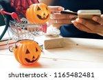 halloween accessories and... | Shutterstock . vector #1165482481
