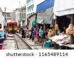 maeklong railway market ... | Shutterstock . vector #1165489114