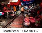 maeklong railway market ... | Shutterstock . vector #1165489117