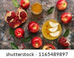 red apples  pomegranate and... | Shutterstock . vector #1165489897
