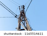 pole with high tension wires on ... | Shutterstock . vector #1165514611