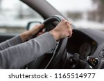 driver's hands driving a car on ... | Shutterstock . vector #1165514977