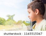 boy 5 years old with interest... | Shutterstock . vector #1165515367