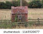 waterside pump house  bricks... | Shutterstock . vector #1165520077