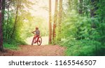 child on a bicycle in the... | Shutterstock . vector #1165546507