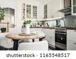 bouquet of tulips in interior... | Shutterstock . vector #1165548517
