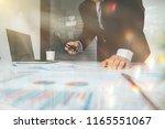 businessman glasses holdmaking...   Shutterstock . vector #1165551067