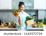 woman in kitchen with various... | Shutterstock . vector #1165572724