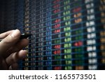 financial data on a monitor as... | Shutterstock . vector #1165573501