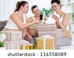 Group of female friends with pregnant woman at a baby shower - stock photo