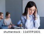 stressed millennial woman... | Shutterstock . vector #1165591831
