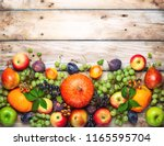 thanksgiving background with... | Shutterstock . vector #1165595704