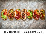 set of assorted bruschetta ... | Shutterstock . vector #1165595734