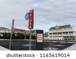 parking kiosk at beach vacation ... | Shutterstock . vector #1165619014