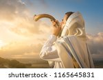 A jewish man blowing the shofar ...