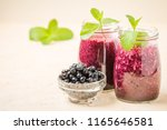 blueberry smoothie decorated... | Shutterstock . vector #1165646581