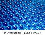bright blue gel balls. hydrogel.... | Shutterstock . vector #1165649134