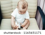 child of rubles sitting on the... | Shutterstock . vector #1165651171