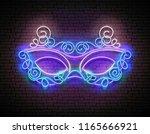 mardi gras masquerade mask.... | Shutterstock .eps vector #1165666921