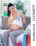 happiness pregnant woman at home after shopping - stock photo