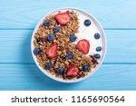 yogurt with granola and berries ... | Shutterstock . vector #1165690564