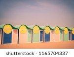 beach cabins in dunkirk.... | Shutterstock . vector #1165704337