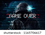 game over concept with hooded... | Shutterstock . vector #1165706617