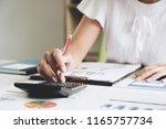 close up business woman using... | Shutterstock . vector #1165757734