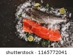 fresh raw trout fish steak and... | Shutterstock . vector #1165772041