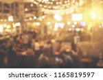 blur people in restaurant.... | Shutterstock . vector #1165819597