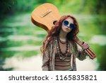 beautiful hippie girl posing... | Shutterstock . vector #1165835821